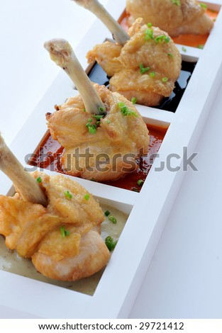 Grilled chicken wings with hot pepper sauce barbecue. - stock photo