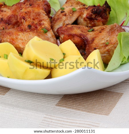 Grilled chicken wings with potatos - stock photo