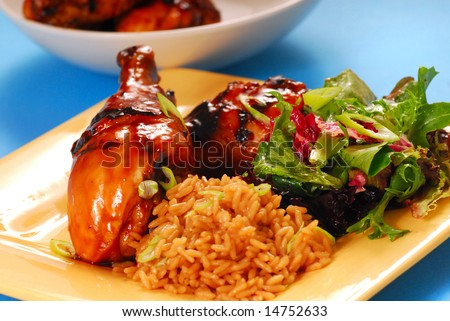 Grilled chicken with a honey and balsamic glazed asian chicken with brown rice and salad - stock photo