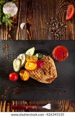 Grilled Chicken with BBQ Vegetables and Spicy Sauce - stock photo