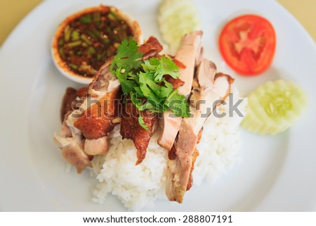 Grilled chicken with Rice and spicy sauce.Thai food - stock photo