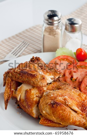 Grilled chicken with vegetables. - stock photo