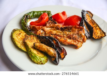Grilled chicken with vegetables - eggplant, zucchini, tomato, pepper - stock photo