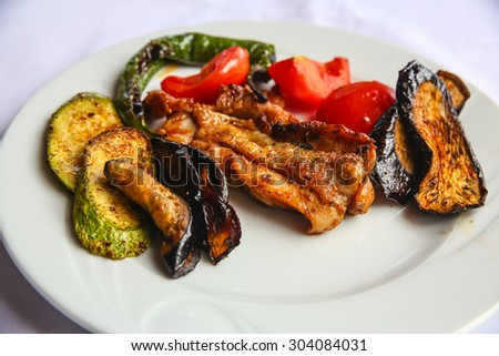 Grilled chicken with vegetables - eggplant, zucchini, tomato, pepper