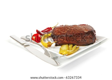 grilled chunk of beef meat with tomato and peppers - stock photo