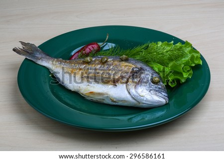 Grilled dorado with salad leaves and dill - stock photo