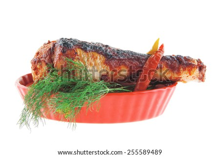 grilled drumstick with greenery on white background - stock photo
