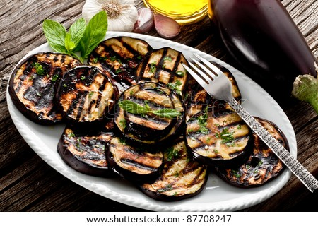 grilled eggplants seasoned with olive oil, garlic and mint - stock photo