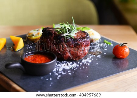 grilled fillet steak served with tomatoes  - stock photo