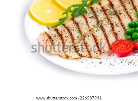 Grilled fish fillet with vegetables. Whole background. - stock photo