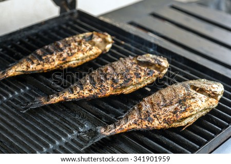 grilled fish on the grill closeup - stock photo