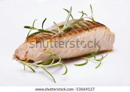 Grilled fish, salmon steak closeup