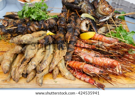 Grilled fish, shrimp, mussels and seafood sticks. Street food