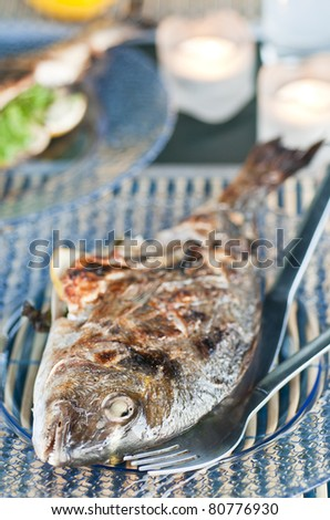 Grilled fish with lemon and parsley - stock photo
