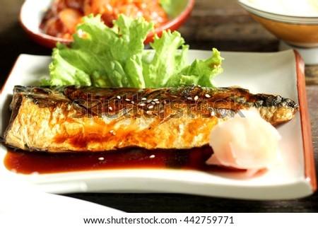 Grilled fish with sauce Saba fish teriyaki sauce, Japanese style, with dark brown wood - stock photo