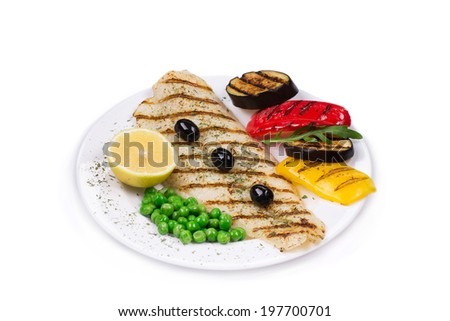 Grilled fish with vegetables close up isolated on the white background. - stock photo