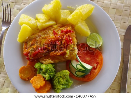 Grilled fish with veggies and potatoes: barracuda for lunch in Kuna Yala, Panama.