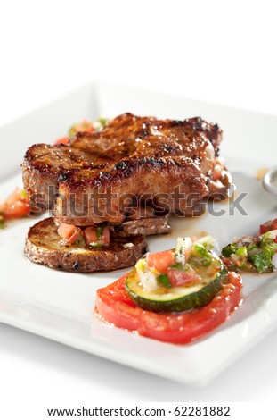 Grilled Foods - BBQ Pork on Potato with Vegetables - stock photo