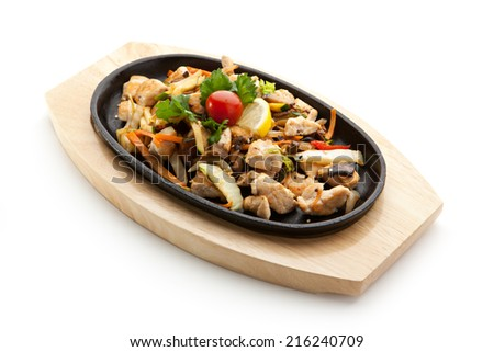 Grilled Foods - Fillet of Chicken with Vegetables. Garnished with Cherry Tomato, Lemon and Parsley - stock photo