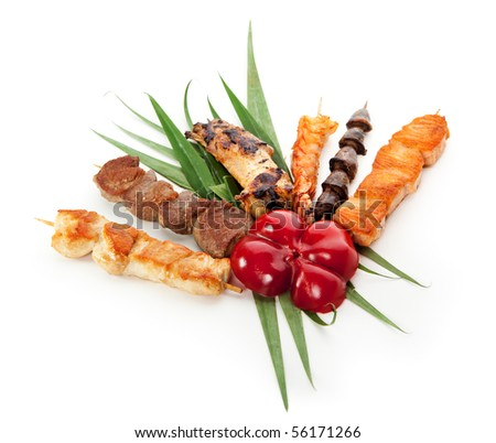 Grilled Foods Garnished with Green Leaves and Paprika - stock photo