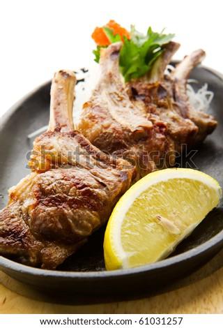 Grilled Foods - Rack of Lamb with Parsley, White Radish and Lemon Slice - stock photo