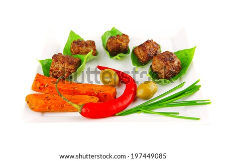 grilled french cutlets served on basil leafs - stock photo