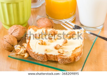 grilled French toast with butter and nuts - stock photo