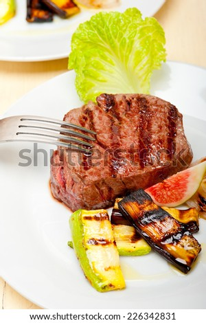 grilled fresh beef filet mignon and vegetables