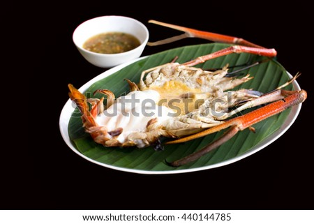 Grilled fresh King prawn with spicy sauce isolated in black background - stock photo