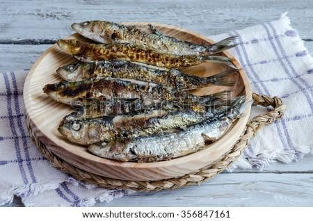 Grilled fresh sardines - stock photo