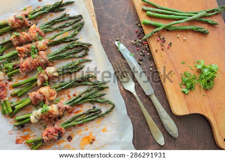 Grilled green asparagus and wrapped in bacon  - stock photo