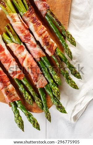 Grilled green asparagus wrapped with bacon - stock photo