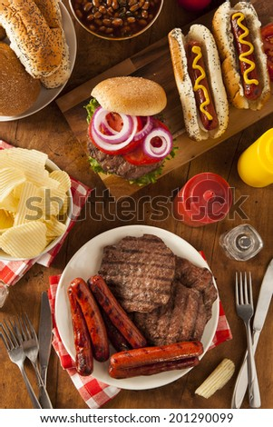 Grilled Hamburgers and Hot Dogs Ready to Eat - stock photo