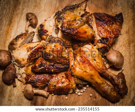 grilled healthy chicken cooked on a summer fresh herbs on a wooden board, close up view