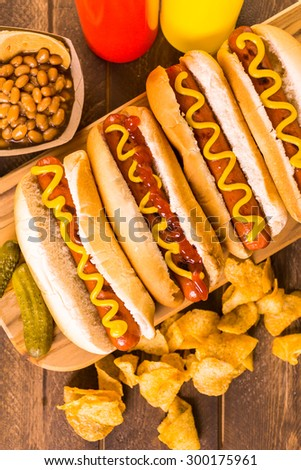 Grilled hot dogs on a white hot dog buns with mustard and ketchup. - stock photo