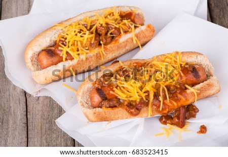 Grilled hot dogs with chili and cheese