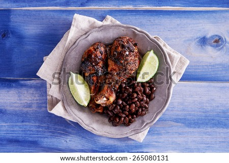 grilled jamaican jerk chicken with black beans shot top down - stock photo