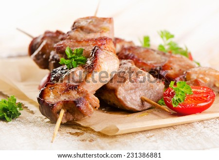 Grilled Kebab served with fresh vegetables . Selective focus - stock photo