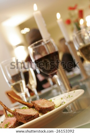 grilled lamb chops, vegetables and vine - stock photo
