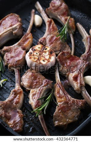 Grilled lamb meat ribs with spices, garlic and rosemary in a pan grill - stock photo