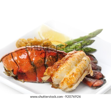 Grilled Lobster Tail Served With Asparagus And Onion - stock photo