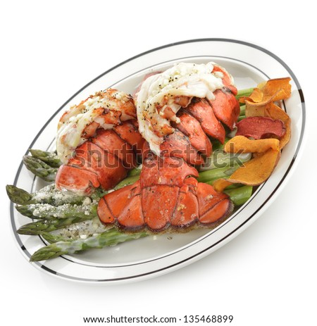 Grilled Lobster Tail Served With Asparagus On White Background - stock photo