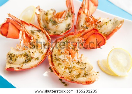 Grilled lobster tails - stock photo