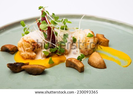 Grilled lobster with sauce and decorations, set on a plate, prepared at a restaurant - stock photo