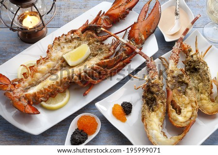 grilled lobster with seafood sauce and caviar - stock photo