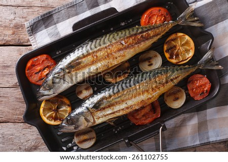grilled mackerel fish on a grill pan closeup. horizontal view from above