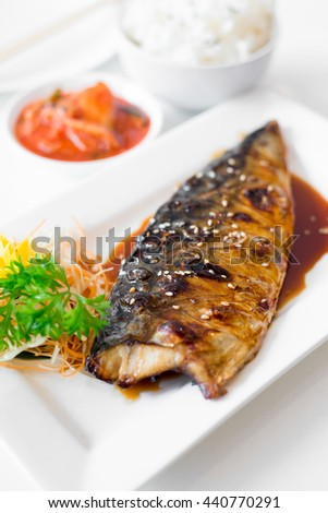 grilled mackerel(Saba) steak with teriyaki sauce and rice on white dish, popular japanese cuisine