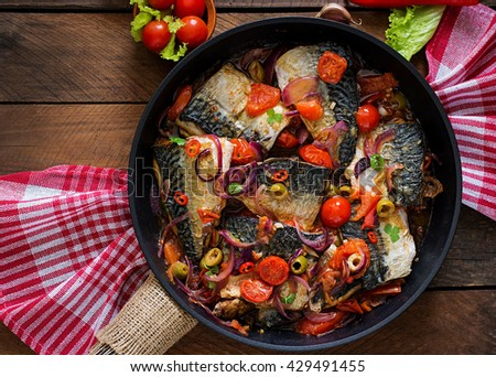 Grilled mackerel with vegetables in Mediterranean style. Top view - stock photo