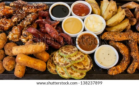grilled meat and sausages in the range with a set of sauces