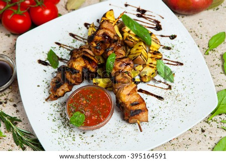 Grilled meat, grilled meat on plate shish kebab on skewers. - stock photo